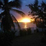 Sunset from the garden of 172 Seaside Drive which is a beautiful beach front property for sale in Barbados