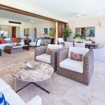 Open plan living & terrace dining at Port Ferdinand which are luxury marina residences for sale in Barbados