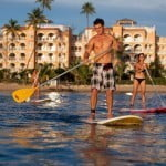 Paddle Boarding at Saint Peter's Bay which are luxury residences in Barbados for sale