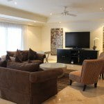 Living room at Sandy Cove 101 which is a luxury beachfront apartment for sale in Barbados on the West coast