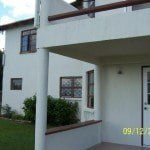 Patio to Apartment of Champaign which is a large property for sale in Barbados