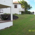 Patio and Lawns to the East side of Champaign which is a large property for sale in Barbados