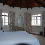 Master bedroom of Champaign which is a large property for sale in Barbados