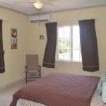 Master bedroom of 8 Coral Haven which is a beautiful short term rental in Barbados